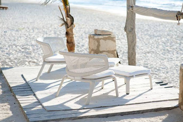 Patio things dedon seashell collection armchair for Breezy beach chaise
